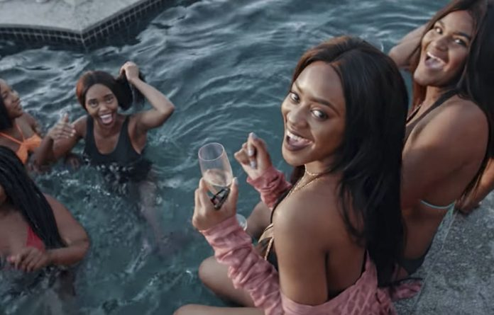 Champagne showcase: A video still from Monate Mpolaye by DJ Sumbody. The visuals reflect expensive lifestyles