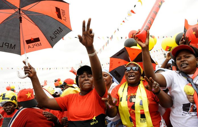 Angolan ruling Popular Movement for the Liberation of Angola party supporters attend the final rally of Angolan President Jose Eduardo dos Santos.