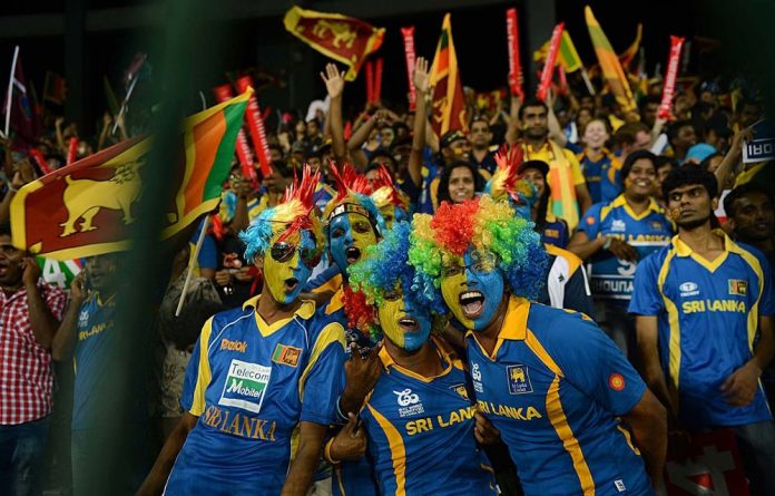 Sri Lankan fans cheer on their team during the T20 World Cup final in Colombo on Sunday.