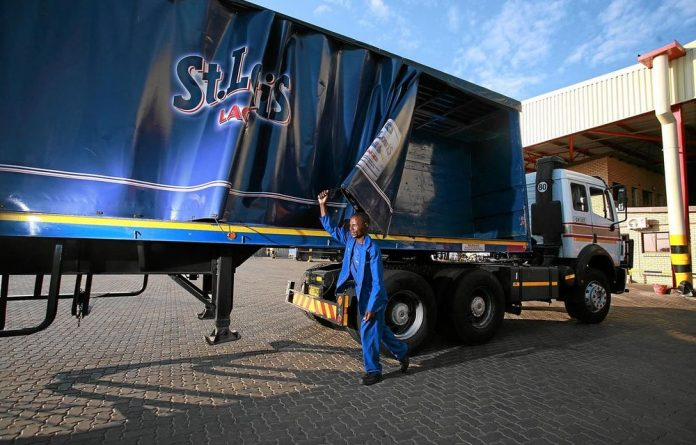 An SABMiller truck prepares to load beer for a Botswana delivery.