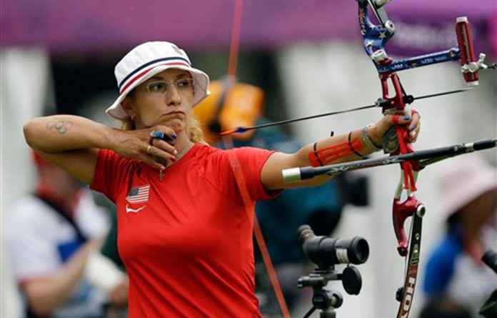 United State's Khatuna Lorig releases her arrow during an individual ranking round at the 2012 Summer Olympics in London.