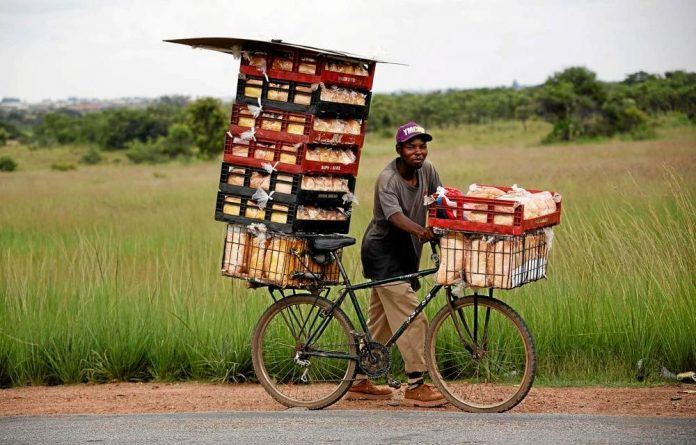 Going it alone: Reselling bread at a farm makes ends meet for this unidentified man.