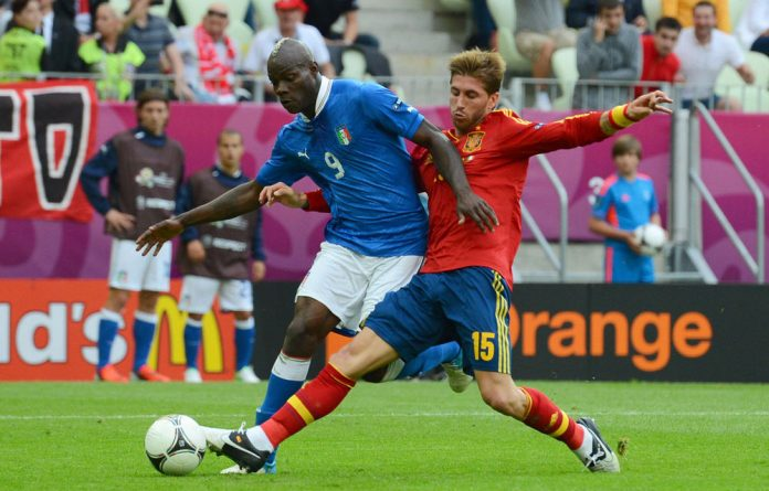 Sergio Ramos of Spain tackles as he attempts to shoot at goal during the Uefa Euro 2012 group C match between Spain and Italy.