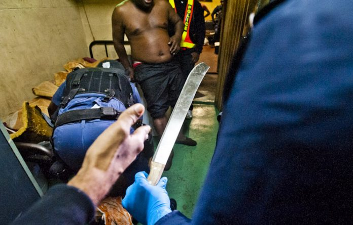 A machete is found during the raid on Jeppestown hostel on Tuesday evening.