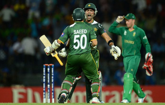 Pakistan's Umar Akmal and Saeed Ajmal celebrate after winning their ICC World Twenty20 Super 8 match against South Africa in Colombo on Thursday.