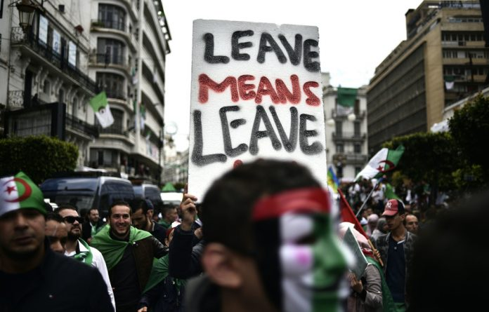 Not fooled: Algerians take part in an anti-government demonstration in the capital after Abdelaziz Bouteflika's key ally