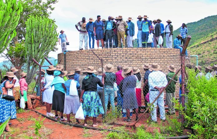 MUS Project National Learning Alliance members viewing refurbished water storage facility in Ga-Mokgotho