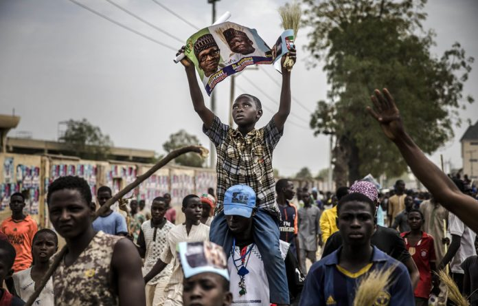 One-sided: APC supporters celebrate a victory in Kano.