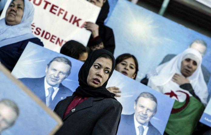 Regime loyalists: Supporters of Algeria's former president Abdelaziz Bouteflika