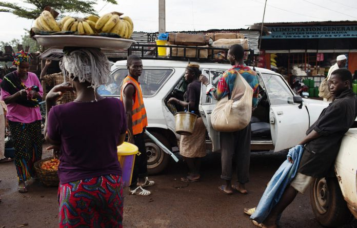 Tripping: The journey to Conakry in Guinea from Bamako in Mali involves a taxi trip interrupted by negotiations with officials at the border and at roadblocks. Photos: Michael Runkel