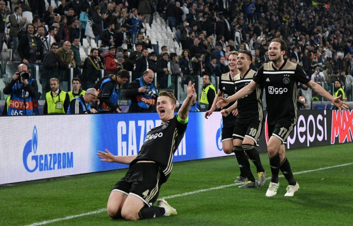 Ajax captain Matthijs de Ligt and his teammates celebrate the winning goal against Juventus.