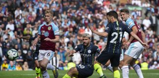 Man City players celebrate against Burnley after Sergio Aguero struck the winner.