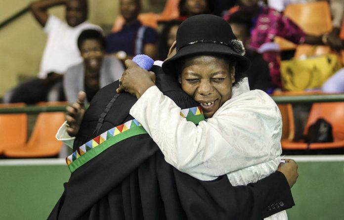 Qualified happiness: University of KwaZulu-Natal graduates and their supporters are known for wearing their hearts on their gowns during graduation season.