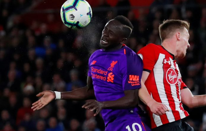 Liverpool's Sadio Mané in action with Southampton's James Ward-Prowse.