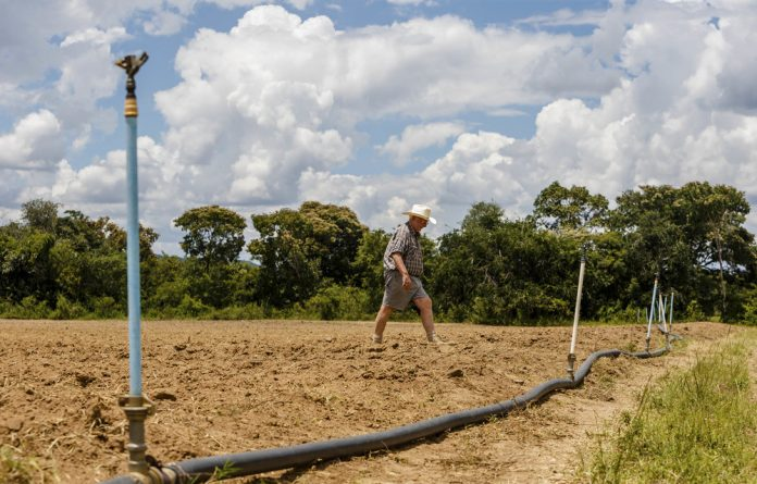 Zimbabwe will pay $18-million to farmers who were affected by land reform and are now in financial distress.