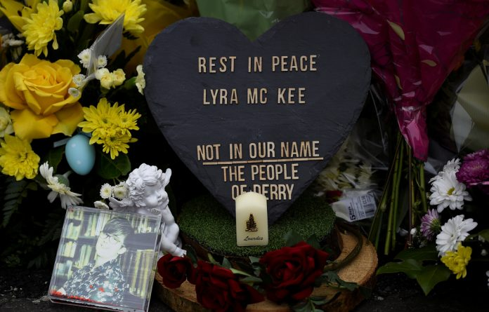 Flowers and a candle are left at the exact spot where 29-year-old journalist Lyra McKee was shot dead