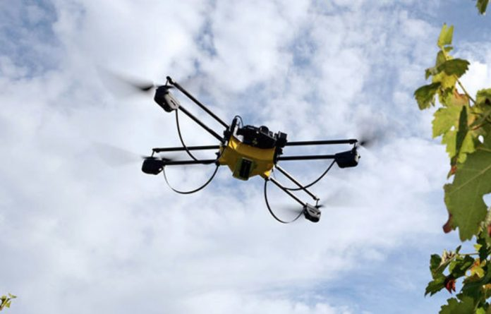 The drone hovers above its destination