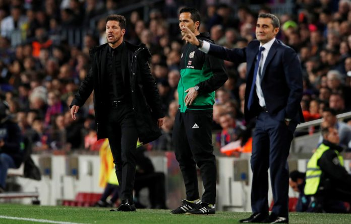 Atletico Madrid coach Diego Simeone and Barcelona coach Ernesto Valverde.