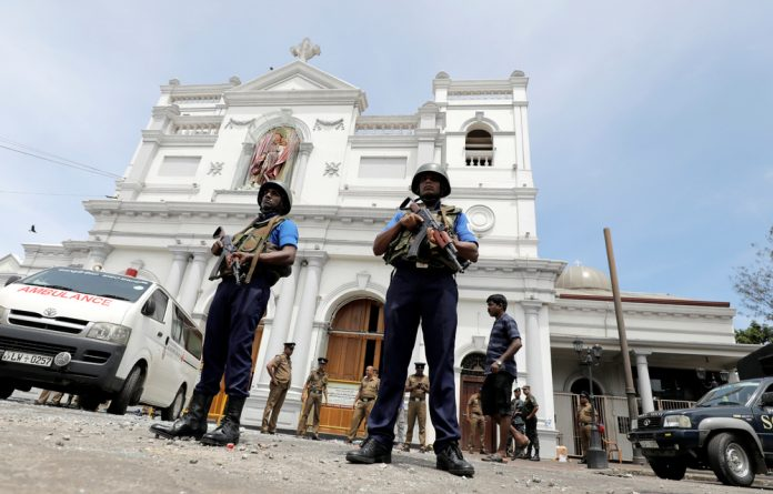 Sri Lankan military officials stand guard in front of the St. Anthony's Shrine