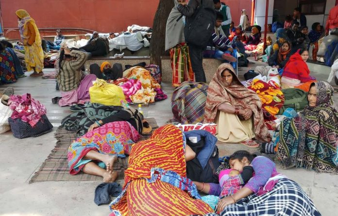 Families await medical treatment outside the All India Institute of Medical Sciences. Ayushman Bharat