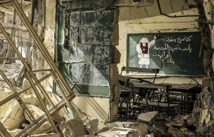 Human rights atrocity: A damaged classroom at a school in Damascus