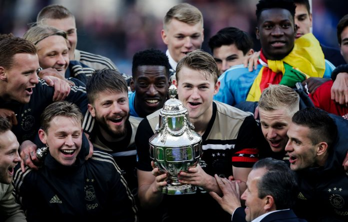 Ajax players celebrate winning the KNVB Cup.