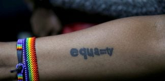 A tattoo of an LGBT activist is seen during a court hearing in the Milimani high Court in Nairobi.