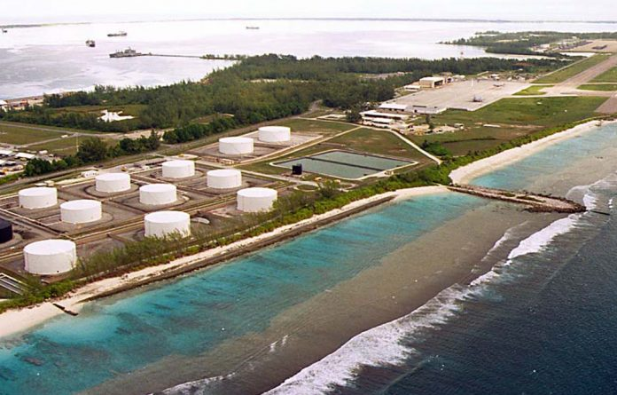 Photo of fuel tanks at the edge of a Military airstrip on Diego Garcia