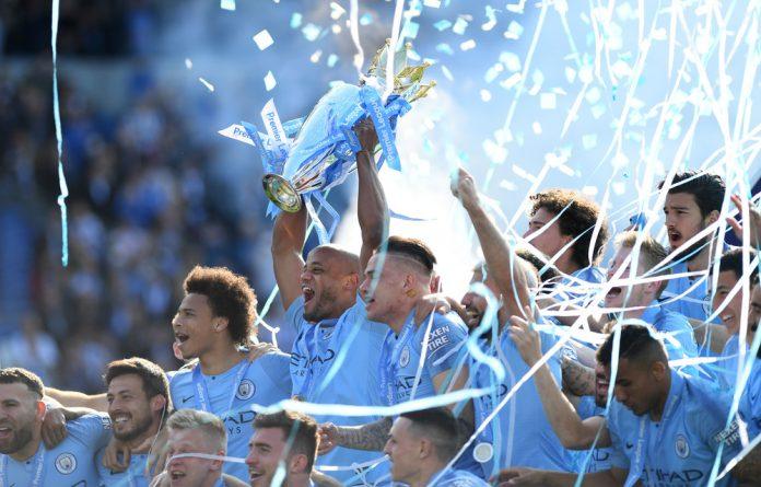 Man City celebrate their second successive Premier League title.