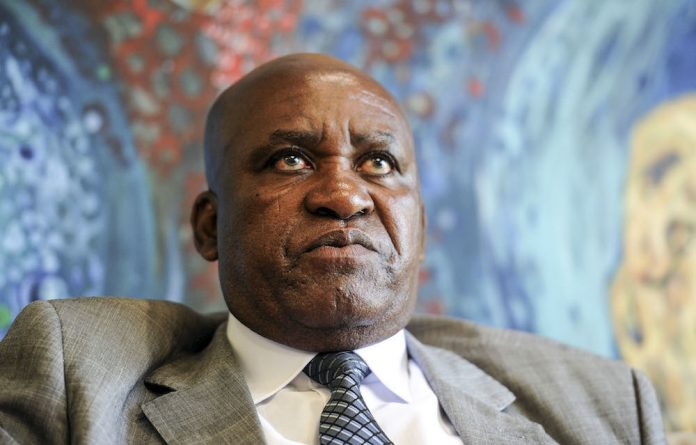 "Former KZN Hawks boss Johan Booysen said that it had already become ""abundantly clear"" that ""Ntlemeza was not somebody to be trusted."""
