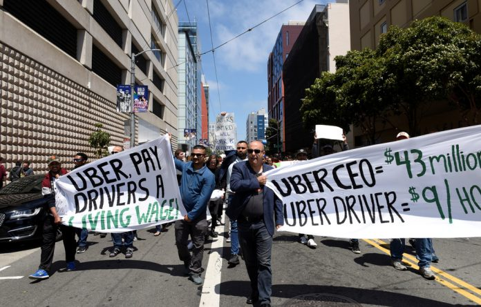 Thousands of Uber and Lyft drivers turned off their apps in a US-wide strike on Wednesday over pay and working conditions.