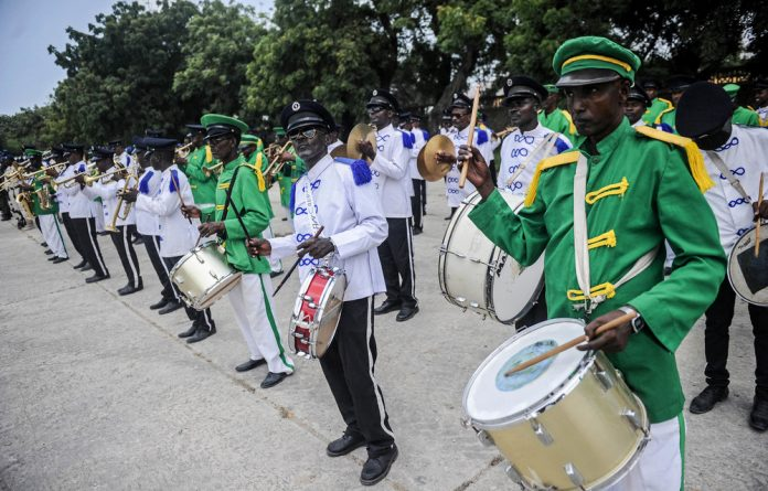 Transition: The Somali police band played at a ceremony when Amisom left Mogadishu Stadium in August.