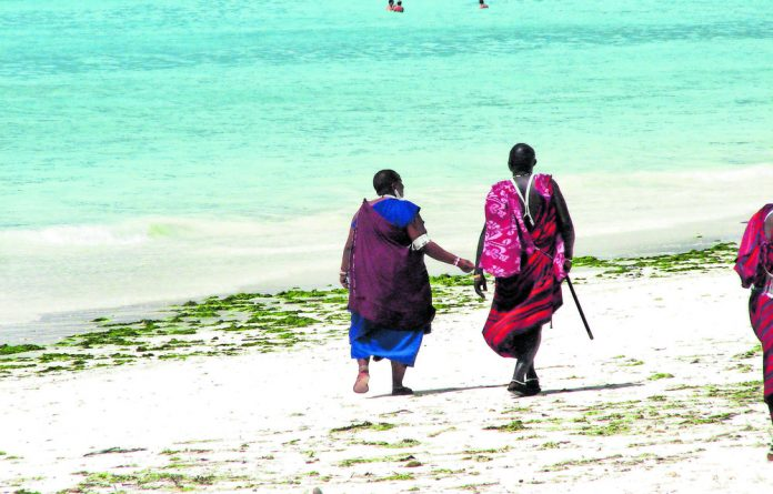 Maasai woman and man on the beach in Zanzibar.