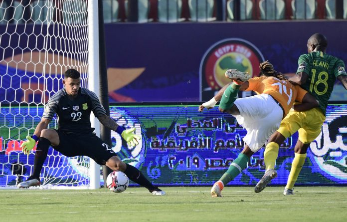 Keeping score: Ivorian forward Jonathan Kodjia gets the ball past South Africa's goalkeeper