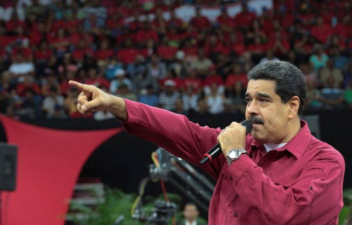President Nicolas Maduro is embroiled in a power struggle with Juan Guaido