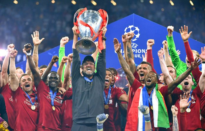Jubilation: Liverpool manager Jürgen Klopp celebrates with his players after winning the Uefa Champions League final against Tottenham Hotspur in Madrid earlier this month.