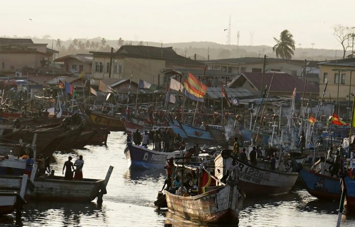 Fishing boats sit in the harbour in Accra