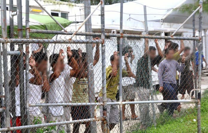 Deprivation: Refugees at the Manus Island processing centre lived as if in prison. They could choose to be deported but few did