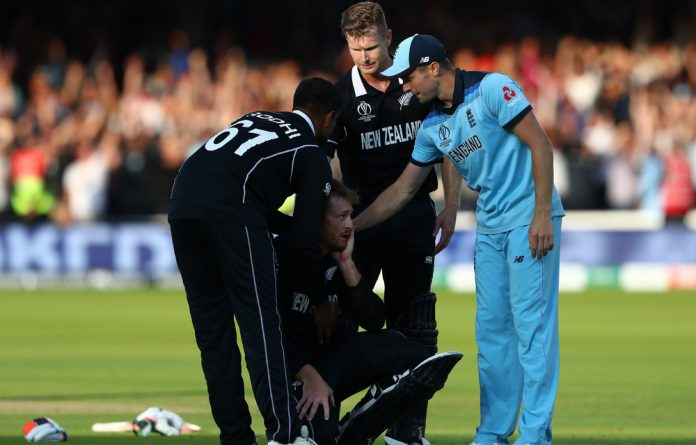 England's Chris Woakes consoles New Zealand batsman Martin Guptill after the most dramatic ODI of all time.