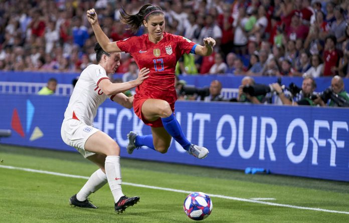 On the ball: England's Fran Kirby battles for possession with the US's Alex Morgan in the semifinal.