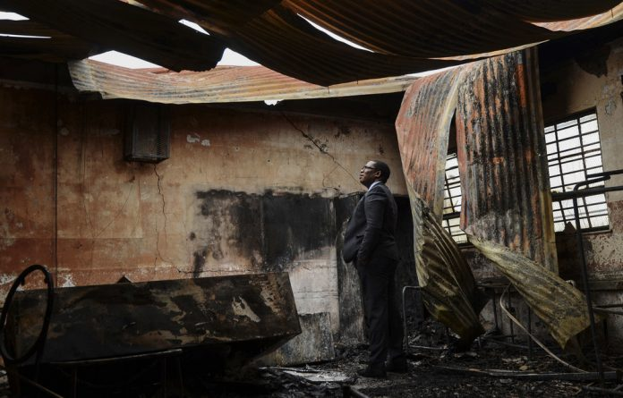 Gauteng Education MEC Panyaza Lesufi assesses fire damage last year at Mohloli Secondary School in Sharpeville. Last week
