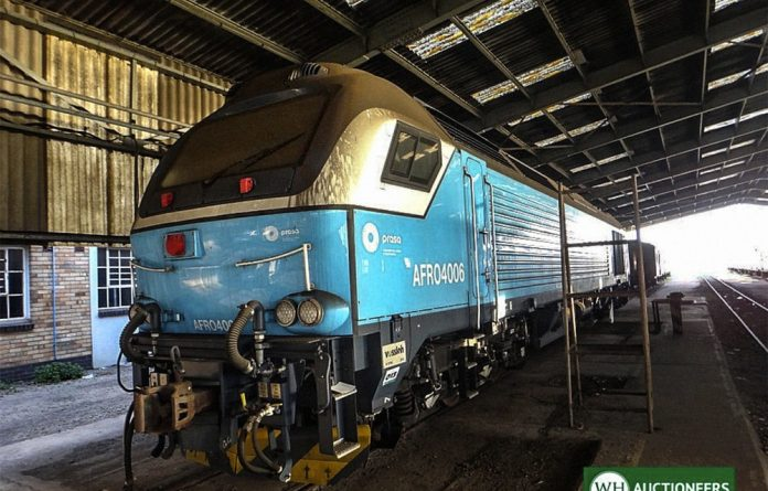 Off the rails: One of the 13 locomotives supplied by Swifambo which are gathering dust at one of WH Auctioneers warehouses are up for auction.
