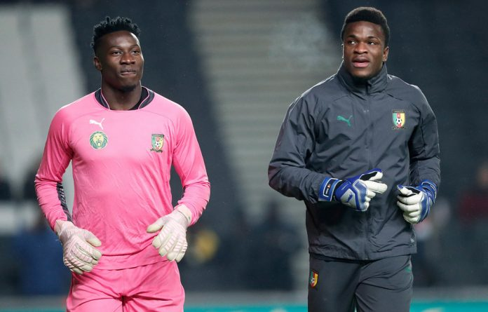 Keeping it in the family: Goalkeepers André Onana and Fabrice Ondoa both play for Cameroon. The cousins have played soccer together for more than a decade.