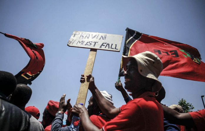 Fighting talk: Economic Freedom Fighters leader Julius Malema waged war against Pravin Gordhan outside the state capture commission of inquiry while the minister testified inside.