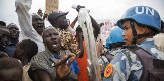 Police fired tear gas at protesters in the northern Khartoum district of Bahri and in Mamura and Arkweit