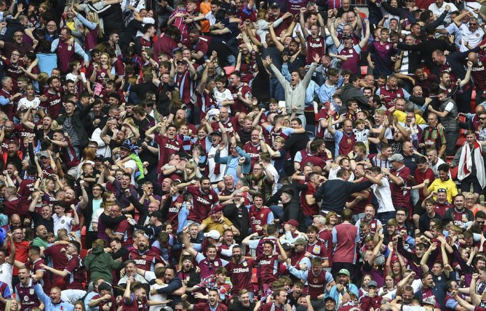 Get in: Fans cheer Aston Villa's first goal during the Championship promotion play-off match against Derby County. The team will be rejoining the Premier League this season.