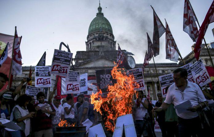 Austerity bites: Demonstrators in Buenos Aires