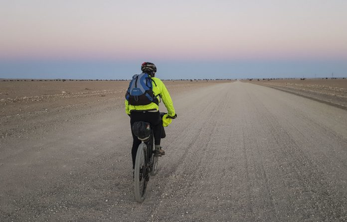 The writer during a 700km ride in Namibia.