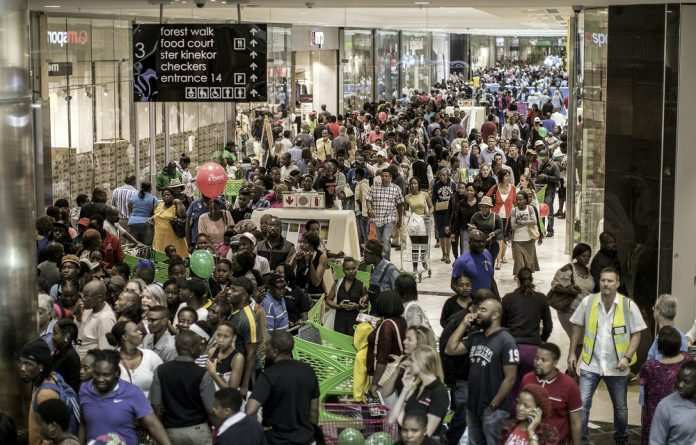 Crowds at the Mall of Africa. The recently signed National Credit Amendment Act aims to provide debt relief for over-indebted consumers who earn less than R7 500 a month. It could have a knock-on effect on retailers.