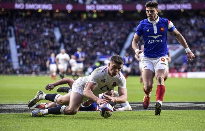 Over the line: England's Owen Farrell scoring his team's sixth try when they played France in the Six Nations. The Roses are among the favourites to win the Rugby World Cup.